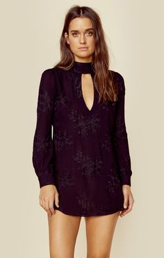 Flynn Skye's Leah Mini Dress features a black floral embroidery throughout, front and back keyhole cutout, and long cuffed sleeves. This style runs slightly short - size up for more coverage.  Made in