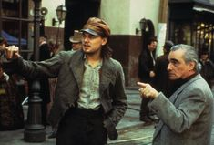 """Leonardo DiCaprio and director Martin Scorsese confer on the set of """"Gangs Of New York"""", 2002.  This was the first collaboration for DiCaprio and Scorsese - they would go on to make four more movies."""