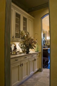 Although this Butler's Pantry is pretty it is the curved drawer fronts that I like. Very nice cabinets. -Shirley