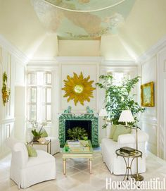 In a Palm Beach maisonette's living room, decorated by Mimi McMakin and former partner Brooke Huttig, the mantel was appliquéd with shells from Christa's South Seashells.   - HouseBeautiful.com