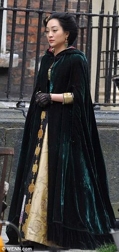 The far east: A woman dressed in ethnic costume was seen walking around set