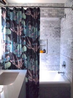 Gorgeous shower curtain by Tonic Living for stunning bathroom designed by Sarah Hartill of House & Home Magazine.Photo credit: Sarah Hartill #tonicliving #homedecor #interiors #bathroomdecor #marbletile
