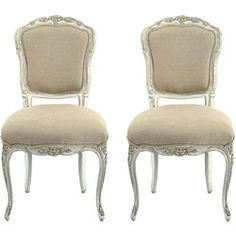Give your home decor a fresh, new touch with a pair of hand-carved chairs  Chairs features a distressed, chippy white finish with cotton/linen blend beige fabric  French country styling defines furniture