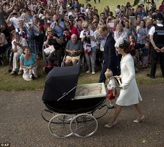 July 5, 2015 - The family are greeted by well-wishers as they make their way to church