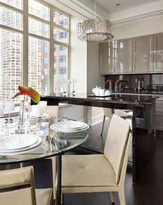 This apartment kitchen's luxurious textures and high-shine accents make it live large. Designed by Mick De Giulio for Doug Atherley's apartment in the Ritz-Carlton Showcase in Chicago