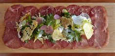 Finely sliced Spanish ham, topped with fresh greens.