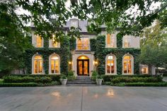 This French-inspired home features a stately symmetrical facade draped in eye-catching climbing vines, which lend color and grandeur to the exterior. The pristine home sits on a .73-acre lot in the heart of Old Preston Hollow and offers massive curb appeal.