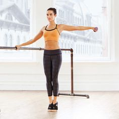 Parallel Quad Burner | STEP 1: Stand with right hand on barre, left arm out to side, a weight in left hand. Rise onto balls of feet, heels touching (as shown); STEP 2: With spine long and core engaged, bend knees and lower for 2 counts, until hips are just above knees (as shown). Return to start in 2 counts. Do 10 reps. Switch sides; repeat.