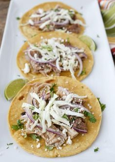Mexican Street Tacos made with the best pork carnitas! get the recipe at barefeetinthekitchen.com