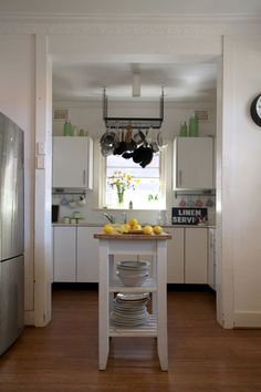 Small kitchen.  Like the storage space for large bowls and platters.