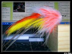 Pike fly, rabbit strip and marabout palmer