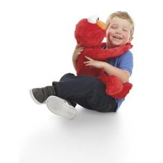 Playskool Sesame Street Big Hugs Elmo - Hugs and he hugs back!  If you lay him down he starts to fall asleep and will sing a lullaby.  So cute - I love Elmo.