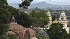The redwood lath structure of the Botanical Building at the left and the twin towers of the Casa del Prado as seen from the California Tower in San Diego's Balboa Park. Don Bartletti/Los Angeles Times