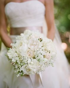 The bride carried garden roses in shades of cream and dusty pink, along with lily of the valley, sweet peas, and lamb's ear.