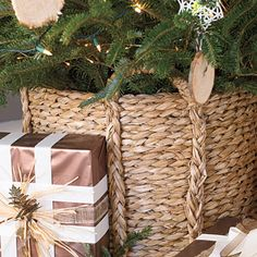 Put Your Tree in a Basket    Skip the usual metal stand and instead use a natural woven basket to hold your Christmas tree. You'll likely still need to support the trunk inside the basket with a stand, but the results are much more beautiful.     Basket (as tree base): Large Round Rush Planter from Coco Company, (847) 398-2626.