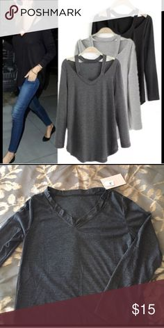 Dark grey v neck cold shoulder t shirt Brand new Reposhing because it's too small. Tag says medium but I think it's more like an XS.  Really cute style I think it would look great on if it fit right. Tops Tees - Long Sleeve