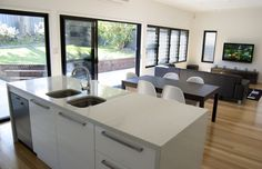 """Kitchen / Dining/ living room with glass walls - bright and airy """"Griannan"""" style"""