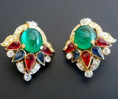 """Here for your consideration is this magnificent """"Jewels of India"""" set of clip style earrings from the 1965 Jewels of India series. This beautiful set was made in the USA by the Trifari Company and designed by Alfred Philippe. The Jewels of India line series is one of the most highly sought after Trifari lines. This particular set of earrings is very collectible and in excellent condition quite rare and hard to find – wearable pieces of art."""