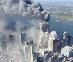 This photo taken September 11, 2001 by the New York City Police Department shows smoke and ash engulfing the area around the World Trade Center as the North Tower collapses in New York. (AP Photo/NYPD, Det. Greg Semendinger)