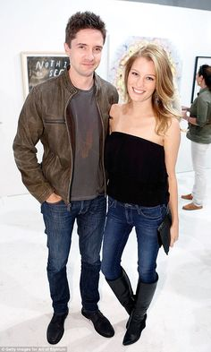 Happy couple: Topher and Ashley were all smiles at a Hollywood event last month...