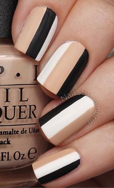Combine these neutral tricolors for your winter nail art. Black, white and nude nail polish goes perfectly together in creating a really classy ensemble.