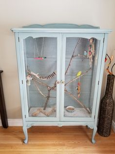 My very first DIY indoor aviary that I repurposed from an old china cabinet. Bra… My very first DIY indoor aviary that I repurposed from an old china cabinet. Branches are natural from the trees in my backyard. Do It Yourself Upcycling, Diy Bird Cage, Decorative Bird Cages, Bird Aviary, Pet Cage, Budgies, Parrots, Diy Stuffed Animals, Beautiful Birds