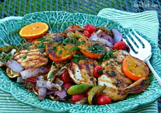 Mojo Chicken Breasts with Grilled Citrus -- oranges, limes, tomatoes and red onions mingle in a tangy garlic herb sauce! A quick and easy recipe for the indoor grill pan or outdoor grill -- a healthy & nutritious dinner the whole family will love, 'cause grilled fruit is delicious! | thefitfork.com