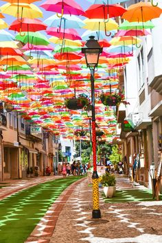 Why to visit Agueda near Aveiro during summer? Because there is this magical sky project with colorful umbrellas in the sky waiting for you. Background Wallpaper For Photoshop, Cute Backgrounds, Bahamas Beach, Portugal Travel Guide, Melbourne Art, Colorful Umbrellas, Urban Furniture, Concrete Furniture, Little Free Libraries