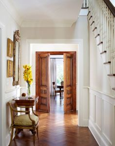 They painted crown moldings and baseboard trim white here, and left doors and windows with stained wood trim. This looks luxe and updated... hmm..