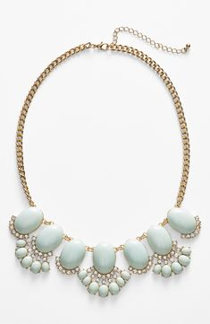 This mint statement necklace is going to look so cute with that new pink blouse.