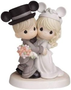 A Precious Moments Disney figurine. Such a cute gift for the bride & groom.