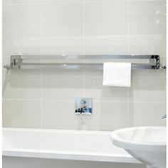 The Memo is a sleek option with many applications, such as being positioned over a bath as pictured, or perhaps above stylish hallway drawers; imagination breathes life into the Memo. Horizontal Radiators, Towel Radiator, Designer Radiator, Heated Towel Rail, Central Heating, Wow Products, Innovation Design, Toilet Paper, Branding Design