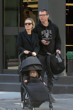 Family day out: Lara and Sam Worthington were quite the coordinated couple on Saturday whi...