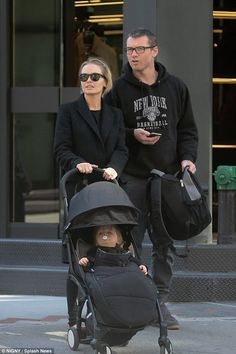 Family day out:Lara and Sam Worthington were quite the coordinated couple on Saturday whi...