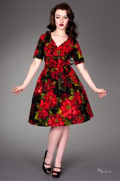 """The perfect holiday dress! """"Betty Poinsettia"""" with lovely red poinsettia flowers on a black background. 1/2 sleeves, flared skirt."""