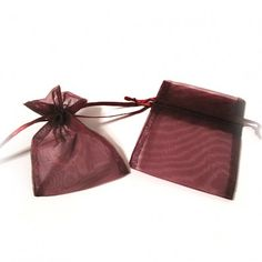 """Burgundy Organza Bags (Set of 10)   Nuptial Knick Knacks    Available is five popular sizes, our bags are made of high quality organza sheer, with a satin drawstrings. Our organza bags have a wide range of use for your bridal needs. They work great for bridesmaids' and guest gift packaging as well as candies and almonds. Choose from 5 different sizes:  3"""" x 4"""", 4"""" x 6"""", 5"""" x 7"""", 6"""" x 10"""" and 6.5"""" x 15""""(Perfect for wine and liquer bottles)"""