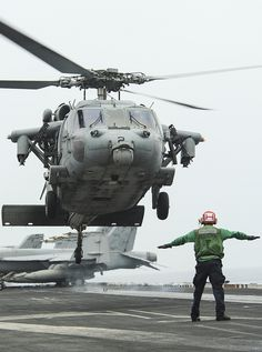 GULF OF OMAN (June 13, 2013) – An MH-60S Sea Hawk helicopter assigned to Helicopter Sea Combat Squadron (HSC) 6 lands on board the aircraft carrier USS Nimitz (CVN 68). Nimitz Strike Group is currently deployed to the U.S. 5th Fleet area of responsibility conducting maritime security operations and theater security cooperation efforts. (U.S. Navy photo by Mass Communication Specialist 1st Class Michael D. Cole/Released)