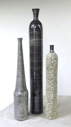 Cool vases.  Minimal Ceramic Bottles Group of 3 wheel-thrown Pottery vessel, Christmas decor, Neutral Grey Black Mid Century Modern BlueRoomPottery. $535.00, via Etsy.