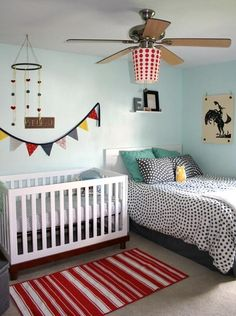 pale aqua walls and understated cowboy. i really like the print on the wall and the red striped throw rug.