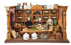 A Well-Filled German Wooden Toy Grocery and Shop-Keepers 2500/3500