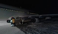 A Travel Service Boeing 737-800 registration OK-TVP performing Flight 7127 from Egypt to Katowice Poland with 179 pax and 6 crew landed and overran the end of the runway and came to a stop with the nose gear and right main gear on soft ground.