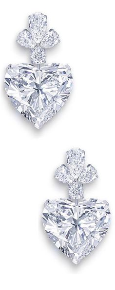 "The Graff ""Sweetheart"" Earrings are set with two perfectly matching heart-shaped diamonds, each of which exceeds 50 carats (that's right - FIFTY carats each!) (=)"