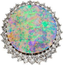 Opal, Diamond, Platinum Ring-Dant The ring features an opal tablet measuring 25.00 x 24.00 mm, encircled by full-cut diamonds weighing a total of approximately 4.25 carats, set in platinum. The top of the ring may be removed and worn as a pendant. Gross weight 27.99 grams.