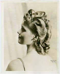 Fashion, World of - Models - Hairstyles - Side profile of model. (1939-40)