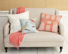 small loveseat and pretty pillows.