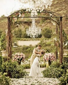 The altar will be lined with purple queen flowers, vines, twigs and a classic chandelier for a homey yet elegant feel.