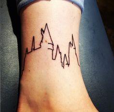 tatuaje horizonte de ciudad