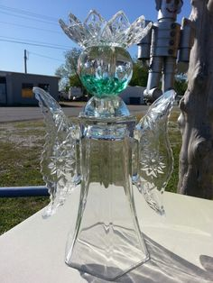 Repurposed glass garden angel.