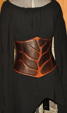 one of a kind handmade hard leather corset hand sewn, carved and dyed  size: fit on waist 29 1/2 to 32