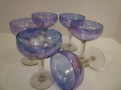 Absolutely gorgeous stemware. Color fluctuates with the light from blues to lavenders. Fabulous, very fine vintage stemware. Elegant florals